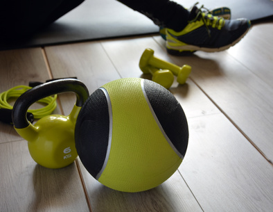 ketlebell with medicine ball and two dumbbells and a rope to jump